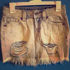 Shredded denim skirt